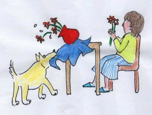 A dog pulls table cloth, knocking down a vase of flowers a woman is working on.