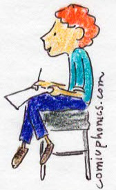 boy on stool writing